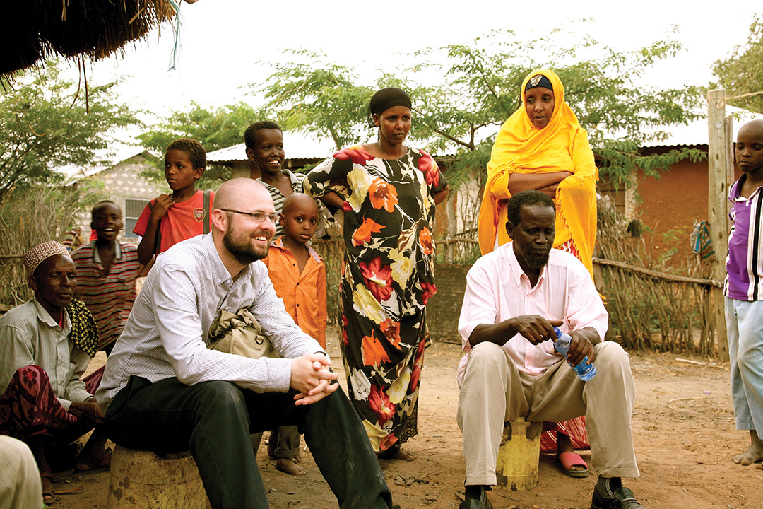 Drew Boyd, left, director of operations for the Sentinel Project, chats with residents of Hamesa village in Garsen, Kenya, in February 2014. THE SENTINEL PROJECT