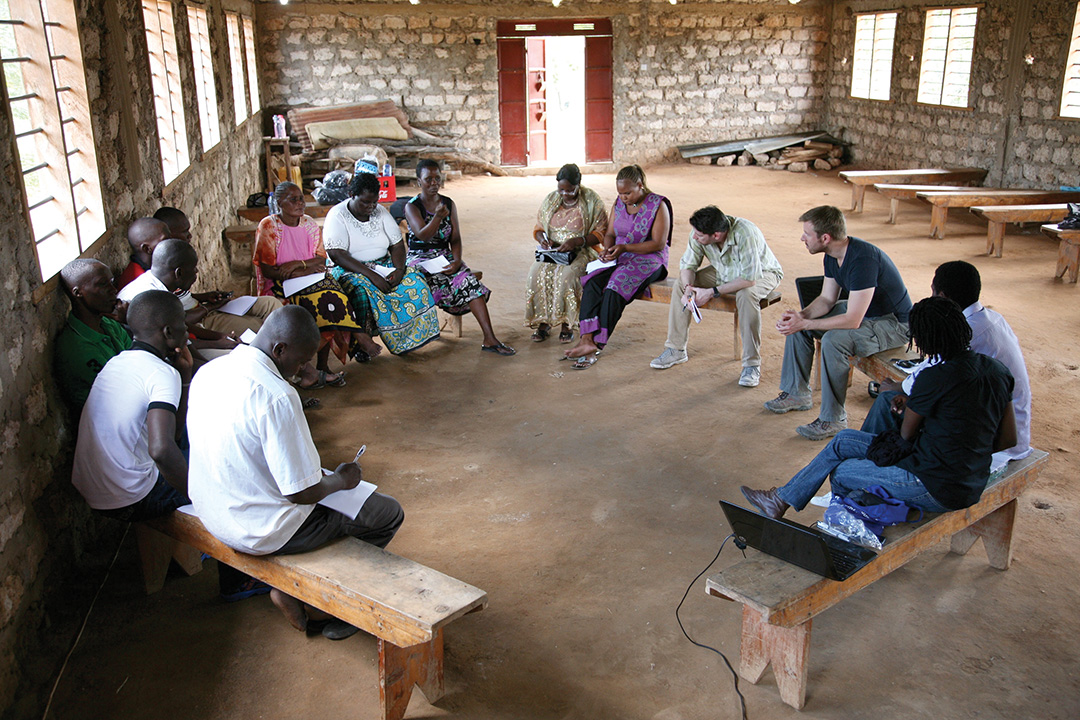 Timothy Quinn, Christopher Tuckwood, John Green Otunga and Christine Mutisya of the Sentinel Project listen to feedback from community ambassadors in Tarassa village in August 2014. THE SENTINEL PROJECT