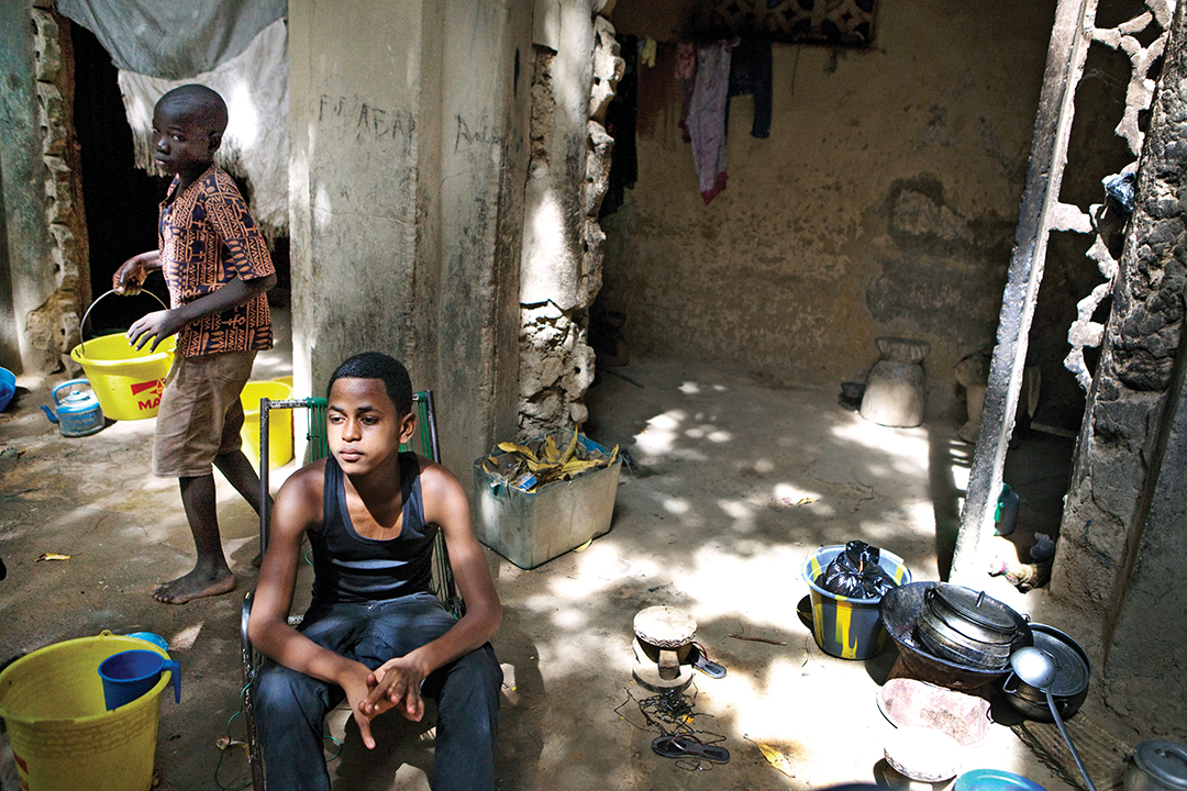 A 16-year-old boy sits in the home of a friend in Mopti, Mali, in 2012 after fleeing the northern part of the country due to fighting. Extremist groups, including ISIS, have sought to radicalize young, marginalized men across Africa. THE ASSOCIATED PRESS