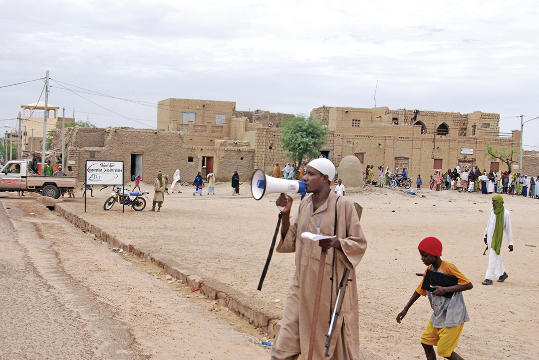 An armed member of the extremist group Ansar al-Dine calls instructions over a bullhorn in the central square of Timbuktu, Mali, before a public lashing. THE ASSOCIATED PRESS